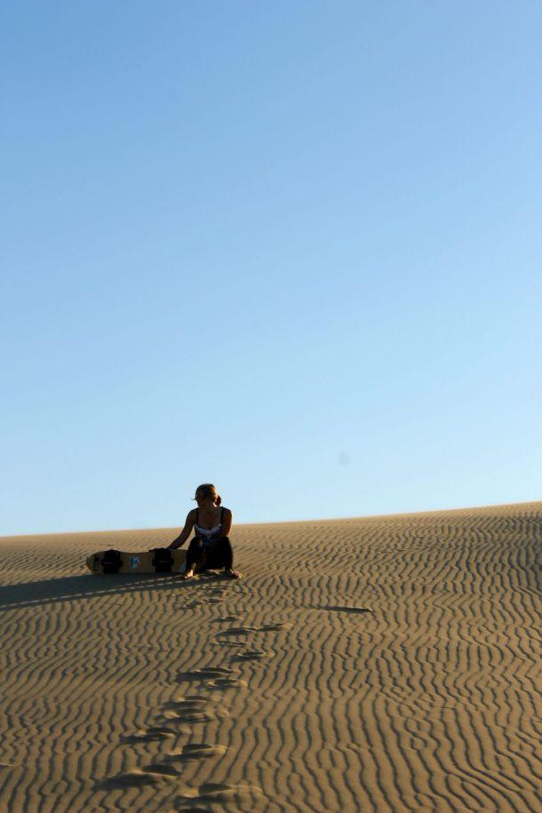Sandboarding Florence's sand dunes